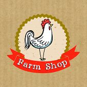 pic of rooster  - Hand drawn cartoon rooster in grungy badge with ribbon banner for the headline isolated on brown kraft paper background - JPG