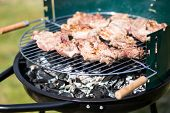 stock photo of gril  - Pork Meat Chop Preparing On Barbecue Gril Outdoors - JPG