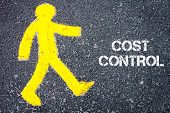 pic of pedestrians  - Yellow pedestrian figure on the road walking towards COST CONTROL - JPG