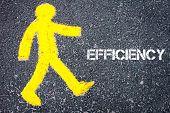 pic of pedestrians  - Yellow pedestrian figure on the road walking towards EFFICIENCY - JPG