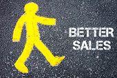 picture of pedestrians  - Yellow pedestrian figure on the road walking towards BETTER SALES - JPG