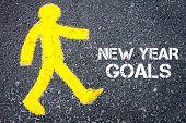 stock photo of pedestrians  - Yellow pedestrian figure on the road walking towards NEW YEAR GOALS - JPG