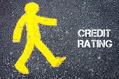 stock photo of pedestrians  - Yellow pedestrian figure on the road walking towards CREDIT RATING - JPG
