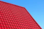 image of roof tile  - Red roof tiles taken closeup against of blue sky - JPG