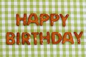 picture of pretzels  - Happy birthday written with pretzel letters on checkered cloth - JPG