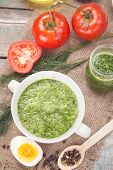 picture of pesto sauce  - sauce of pesto near a tomato olive oil and eggs in a studi - JPG