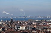 stock photo of polluted  - smokestacks and factories polluting with smoke near Venice in Italy - JPG