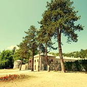 pic of stone house  - Wild angle landscape with medieval stone houses and pine trees - JPG