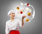 image of juggler  - Juggler chef play with some ingredients and kitchen tools - JPG