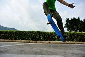 image of parking lot  - young woman skateboarder doing ollie trick at parking lot - JPG