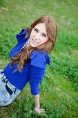picture of piercings  - Attractive cool woman dressed in blue and a piercing in her nose - JPG