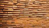 image of wooden pallet  - Wooden timber at a sawmill stacked and ready for sale - JPG