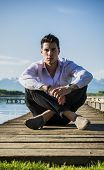 pic of pier a lake  - Handsome young man on a lake in a sunny - JPG