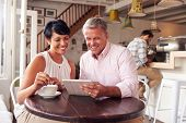 stock photo of internet-cafe  - Middle aged couple in a cafe - JPG