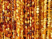 Strings of amber beads. Bright warm background.