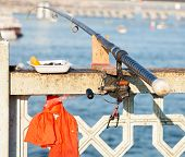 image of rod  - Fishing rod attached to the railing of the Galata Bridge Istanbul Turkey - JPG