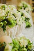 stock photo of wedding table decor  - Wedding table decoration, wedding setting, wedding flowers on table, shallow depth of field. ** Note: Shallow depth of field - JPG