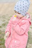 foto of early spring  - a little girl with early spring flower - JPG