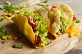 picture of tacos  - Tasty taco with greens on paper close up - JPG
