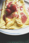 stock photo of crepes  - Homemade Crepes with fresh strawberries on top - JPG