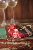 stock photo of stool  - Cured Meat and vintage forks on textured Chalkboard and old wooden stool background - JPG