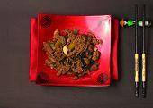 picture of stir fry  - Vietnamese beef stir fry served on a black background - JPG
