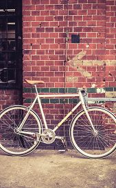 picture of commutator  - City bicycle fixed gear and red brick wall vintage bike - JPG
