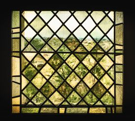 picture of distort  - An old stained glass window with pigmented window panes and leaded glass distorts the French countryside into a a view that looks like an impressionist painting - JPG