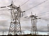 stock photo of nonrenewable  - in the country a pylon and of the electric wire high tension - JPG