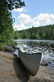 Canoe On The Shore Of A Remote Wilderness Lake