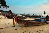 Longboats At Sunset On Phi Phi Island, Thailand