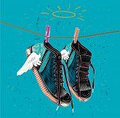 Постер, плакат: Sneakers for printing Classic sneakers with wings Sneakers are dried on a rope