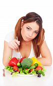 Woman Sitting Near Plate With Vegetables