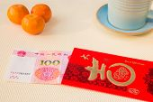 ������, ������: Red Chinese Envelope With Money On A Table