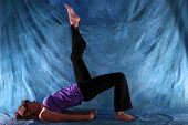 Woman In One Legged Bridge Yoga Pose
