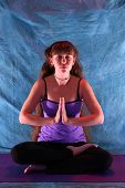 Woman In Half Lotus Yoga Namaste Position