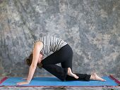 Woman Doing Yoga Posture Marjaryasana Variation Or Strong Cat Pose Left