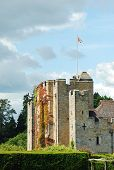 picture of hever  - Hever Castle England with flag flying and cloudy sky - JPG