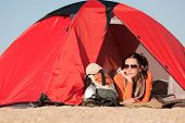 Camping Happy Woman In Tent On Beach