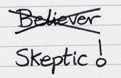 Crossing Out Believer And Writing Skeptic.