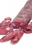 fuet, spanish salami, on a white background