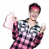 Portrait of an excited trendy young woman holding detergent in studio on white background
