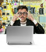 Nerd pensive man with myopic glasses looking for solution on electronics technology problem