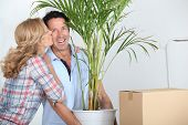 Couple moving in with plant