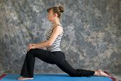 Woman Doing Yoga Posture Low Lunge Or Ashwa Sanchalanasana