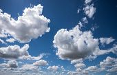 white clouds. in the background a blue sky. beautiful landscape in nature. symbolic photo for climat poster