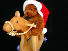 picture of horse wearing santa hat  - Teddy wearing a Santa hat riding his horsey on black isolated background - JPG