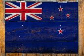 National Flag Of New Zealand On A Wooden Wall Background.the Concept Of National Pride And Symbol Of poster