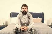 Tips For Waking Up Early. Man Bearded Hipster Sleepy Face Pajamas Waking Up Bedroom Interior. Daily  poster