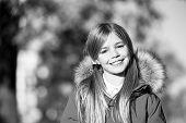 Good Mood At Fall Weather. Kid Girl Wear Coat For Fall Season. Child Cheerful Walking Wearing Warm B poster